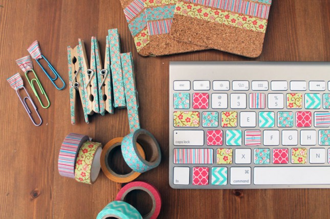paper clips, coasters, pins and a mac keyboard decorated in patterned tape